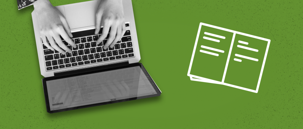 Black and white laptop with person typing green background